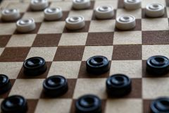 Checkers in checkerboard ready for playing. Game concept. Board game. Hobby. checkers on the playing field for a game. stock photos