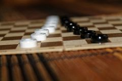 Checkers in checkerboard ready for playing. Game concept. Board game. Hobby. checkers on the playing field for a game. Checkers in checkerboard ready for royalty free stock photos
