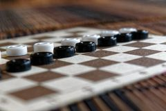 Checkers in checkerboard ready for playing. Game concept. Board game. Hobby. checkers on the playing field for a game. stock photography