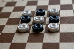 Checkers in checkerboard ready for playing. Game concept. Board game. Hobby. checkers on the playing field for a game. stock photo