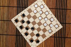 Checkers in checkerboard ready for playing. Game concept. Board game. Hobby. checkers on the playing field for a game. royalty free stock photo