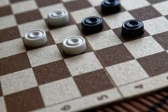 Checkers in checkerboard ready for playing. Game concept. Board game. Hobby. checkers on the playing field for a game. royalty free stock images