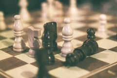 Checkers during a chess game royalty free stock photography