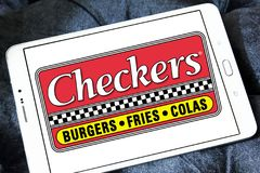 Checkers fast food restaurant logo. Logo of checkers fast food restaurant on samsung tablet Stock Photo