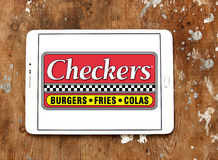 Checkers fast food restaurant logo. Logo of checkers fast food restaurant on samsung tablet on wooden background Stock Images