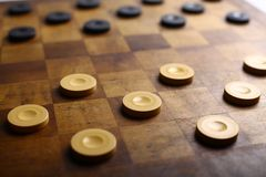 Checkers game. Color shot of a vintage draughts or checkers board game stock image