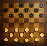 Checkers game. Color shot of a vintage draughts or checkers board game stock photos