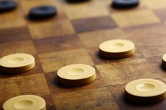 Checkers game. Color shot of a vintage draughts or checkers board game royalty free stock photos