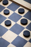Checkers game detail. Color shot of a vintage draughts or checkers board game royalty free stock image