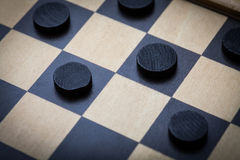 Checkers game detail. Color shot of a vintage draughts or checkers board game royalty free stock photos