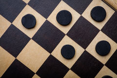Checkers game detail. Color shot of a vintage draughts or checkers board game stock image