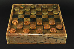 Checkers game. Isolated Checkers game made of stones royalty free stock photography
