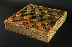 Checkers game. Isolated Checkers game made of stones royalty free stock image