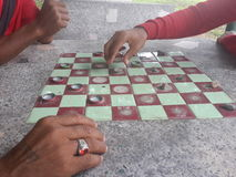 Checkers Game. Play checkers on table royalty free stock photos