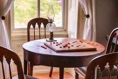 Checkers Game Set Up On a Table. In a Historic Home stock images