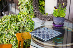 Checkers Game on Wine Barrel Table. Wine barrel table with glass top plays host to this game of checkers royalty free stock photo
