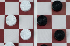 Checkers on gaming board top view Stock Photos