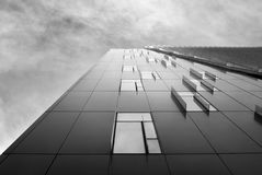 Checkers like office building on a cloudy day, black and white. Royalty Free Stock Images