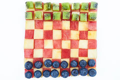 Checkers made from fruits. Fun food. Checkers made from fruits Royalty Free Stock Photography