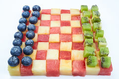 Checkers made from fruits Stock Image