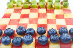 Checkers made from fruits Royalty Free Stock Photos