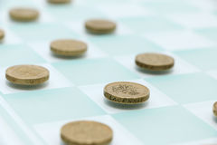 Checkers with Money Royalty Free Stock Images