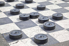 Checkers on the pavement Royalty Free Stock Images