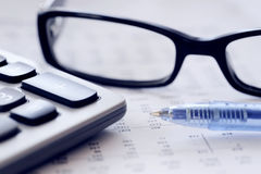 Checking accounts with a calculator Royalty Free Stock Photos