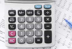 Checking accounts with a calculator Stock Photo
