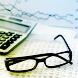Checking accounts with a calculator Stock Photography
