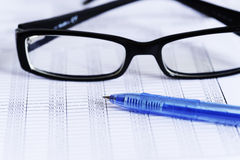 Checking accounts with a glasses Royalty Free Stock Image