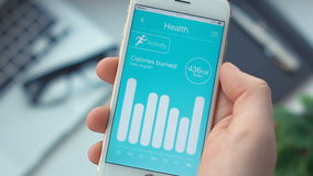 Checking activity monitoring on health app on the smartphone stock video