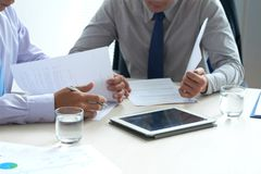 Checking agreements. Cropped image of lawyers checking business contracts Royalty Free Stock Photography