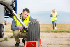 Checking aircraft's tire royalty free stock images