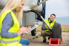 Checking aircraft's tire royalty free stock photography
