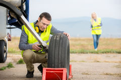 Checking aircraft's tire royalty free stock image
