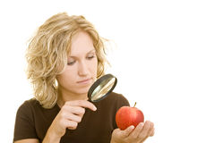 Checking an apple Royalty Free Stock Photo