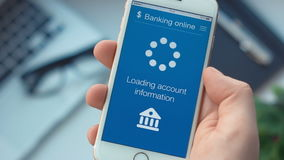 Checking bank account on banking app on the smartphone