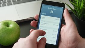 Checking banking activity using banking app. Stock footage stock video footage