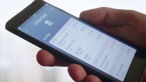 Checking banking activity using banking app. Stock footage stock video