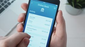 Checking banking activity using banking app. Stock footage stock footage