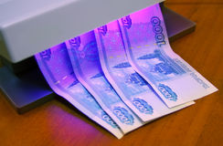 Checking of banknotes. Under UV light Stock Photo