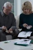 Checking the bills Royalty Free Stock Photo