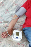 Checking blood pressure. Elderly lady checking her blood pressure at home Stock Photo
