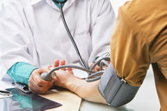 Checking blood pressure Stock Photography