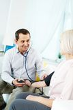 Checking blood pressure Royalty Free Stock Photography