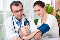 Checking Blood Pressure Royalty Free Stock Photo