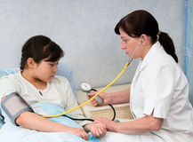 Checking blood pressure Royalty Free Stock Image