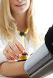 Checking blood pressure. Close-up of Doctor/nurse checking blood pressure with stethoscope Royalty Free Stock Photos