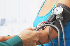 Checking blood pressure of female patient Royalty Free Stock Photos